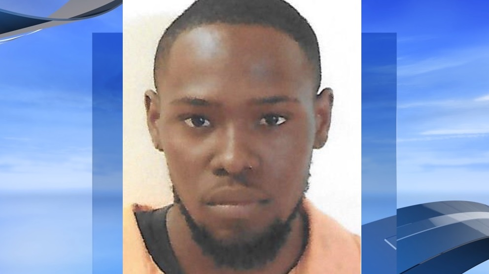 Melik Nijuan Abrams, 20, is charged in a home invasion last week on Montgomery Street in Marion (Marion police. WPDE background)