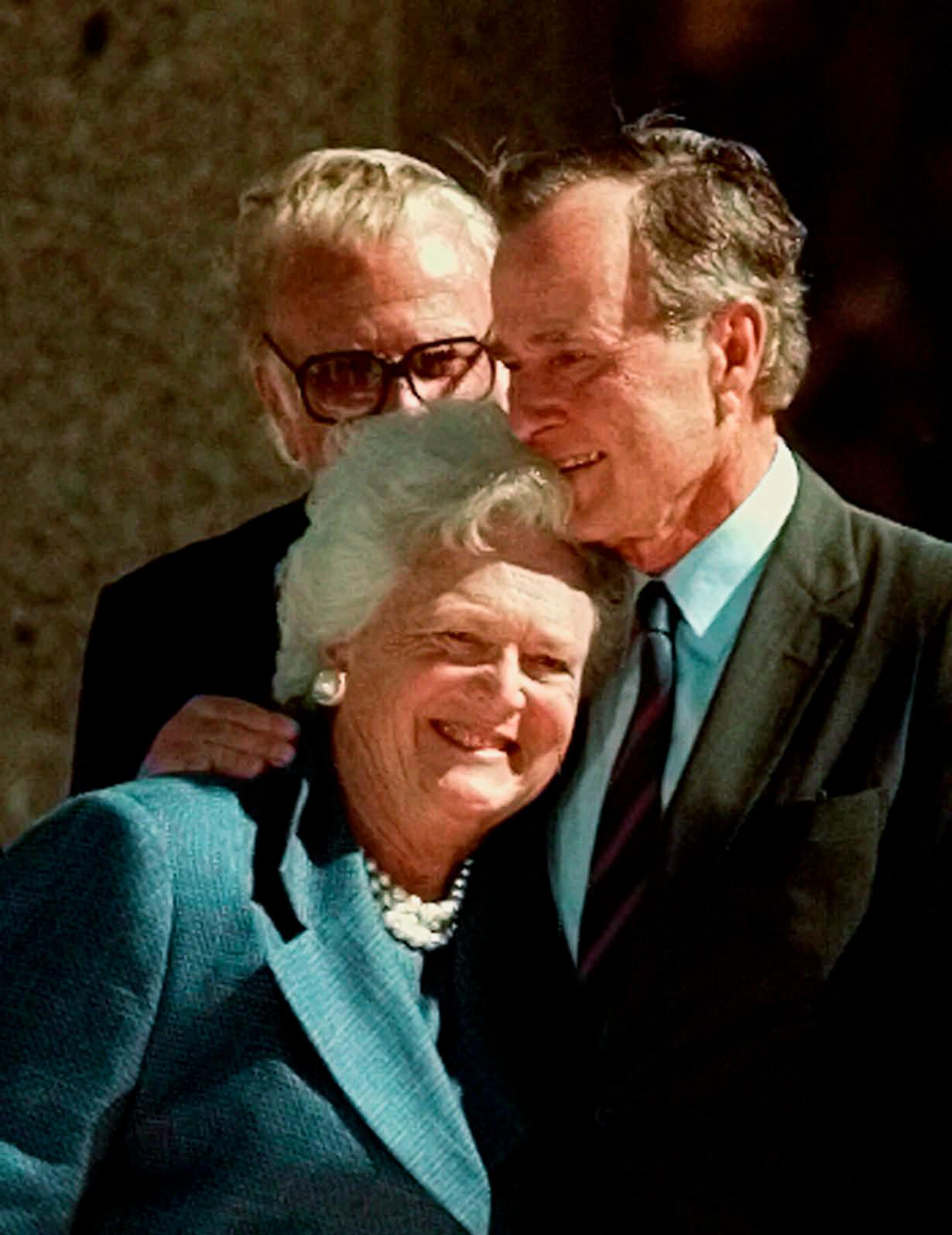 "FILE - In this Nov. 6, 1997, file photo, former President George Bush hugs his wife, Barbara, after his address during the dedication of the George Bush Presidential Library in College Station, Texas. With her husband still at her side, Barbara Bush has decided to decline further medical treatment for health problems and focus instead on ""comfort care"" at their home in Houston. Family spokesman Jim McGrath disclosed Barbara Bush's decision Sunday, April 15, 2018. (AP Photo/Pat Sullivan, File)"