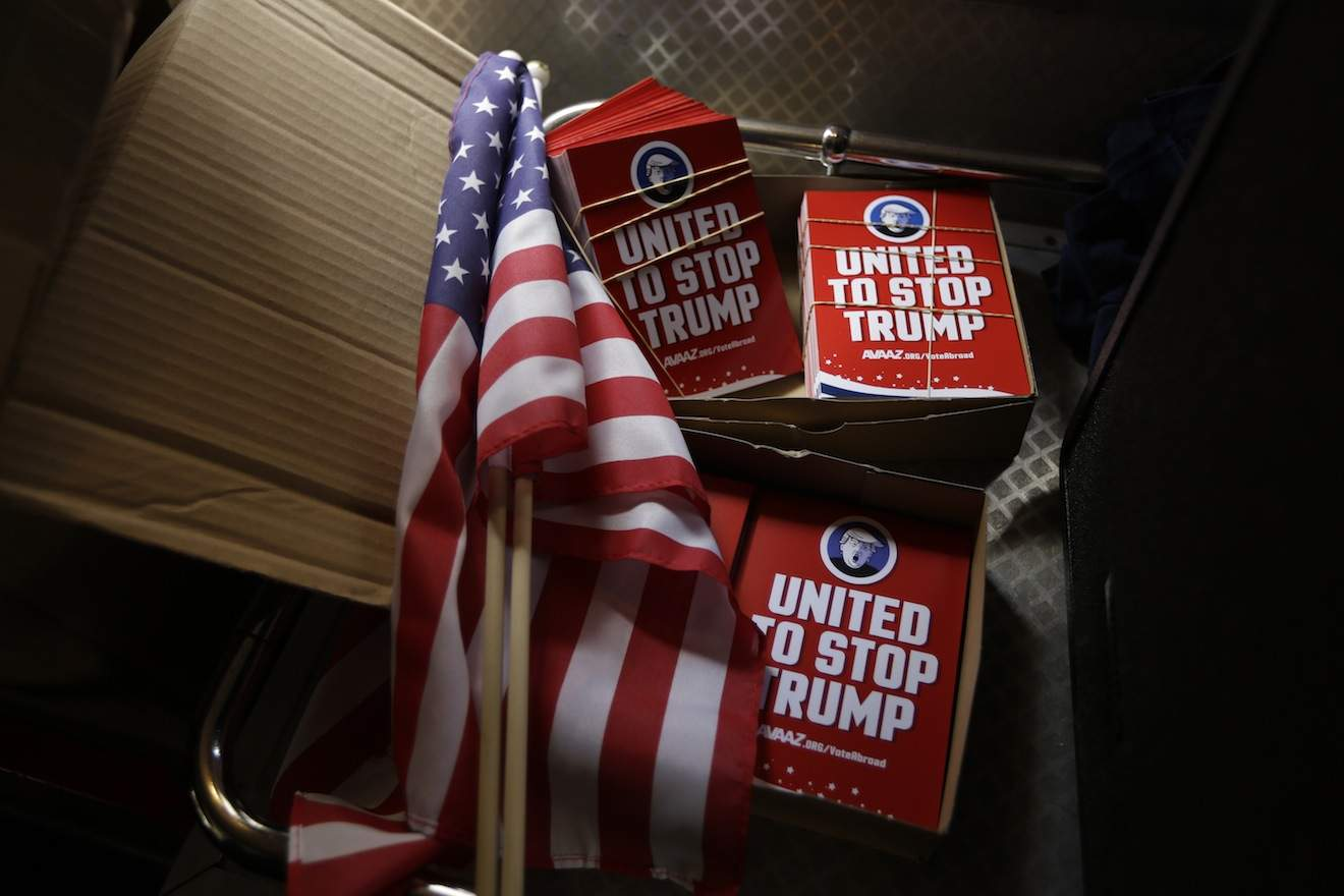 Campaign 'STOP TRUMP' leaflets and U.S. flags ready for distribution from an open top bus, by opponents of U.S. Republican presidential candidate Donald Trump as they tour central London encouraging expats to register to vote in the upcoming United States presidential election, in central London, Wednesday, Sept. 21, 2016. The bus event was organised by the global online campaign movement Avaaz as the deadline to register to vote is approaching in some American states. (AP Photo/Matt Dunham)