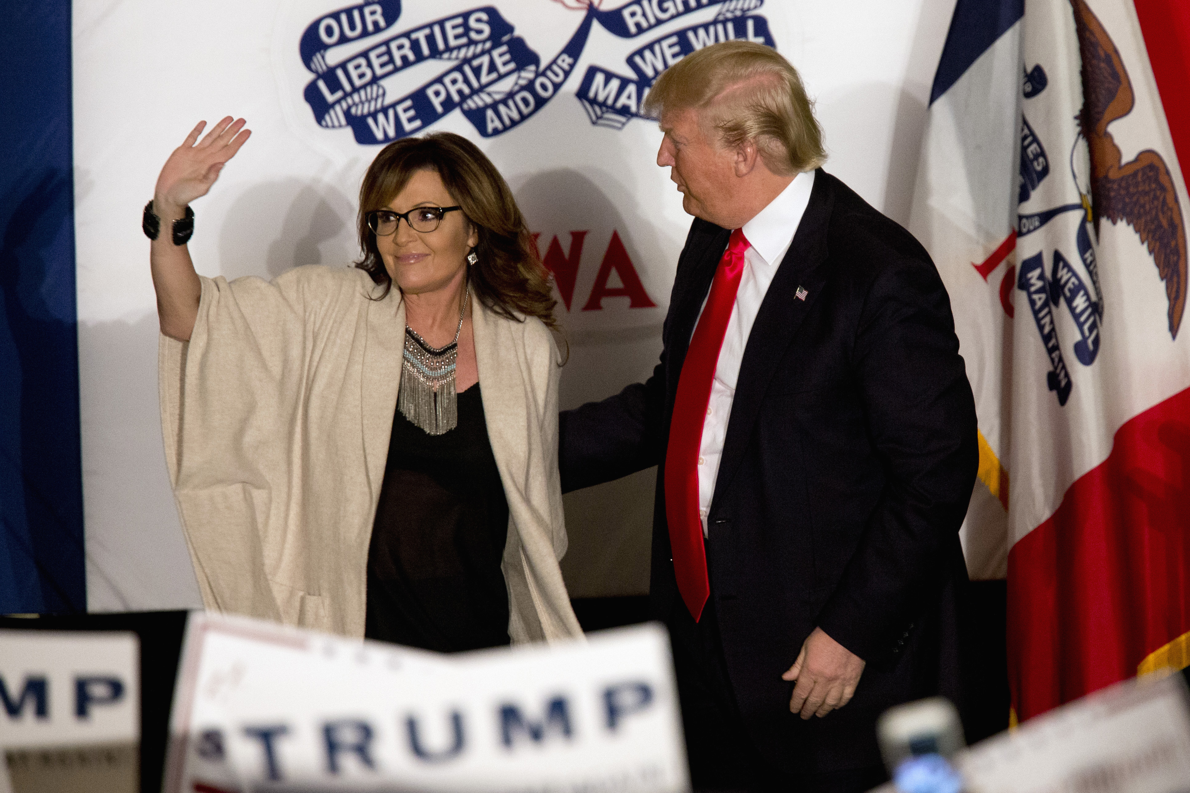 Republican presidential candidate Donald Trump is joined on stage by former Republican vice presidential candidate, and former Alaska Gov. Sarah Palin during a campaign event, Monday, Feb. 1, 2016, in Cedar Rapids, Iowa. (AP Photo/Mary Altaffer)