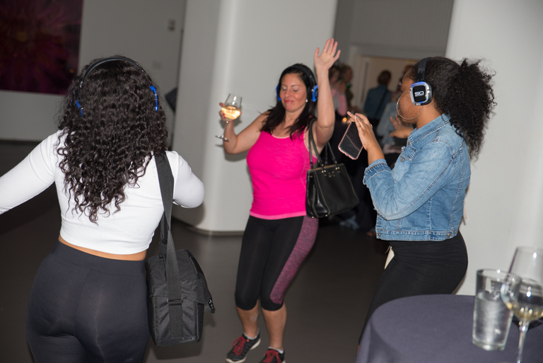 "A Silent Disco dance party was held at the 21c Museum Hotel on Friday, April 13th. Attendees partied the night away with the Sound Off wireless headphone technology, ""let(ting) each attendee control his/her own volume and tune in up to three channels of audio from a live DJ and genre-specific playlists. Each headphone channel illuminates in a different color."" — per the Eventbrite page / Image: Sherry Lachelle Photography // Published: 4.14.18"