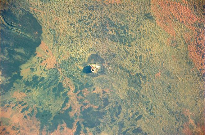 Ayers Rock casts a solitary shadow early in the morning (Photo & Caption: Luca Parmitano, NASA)