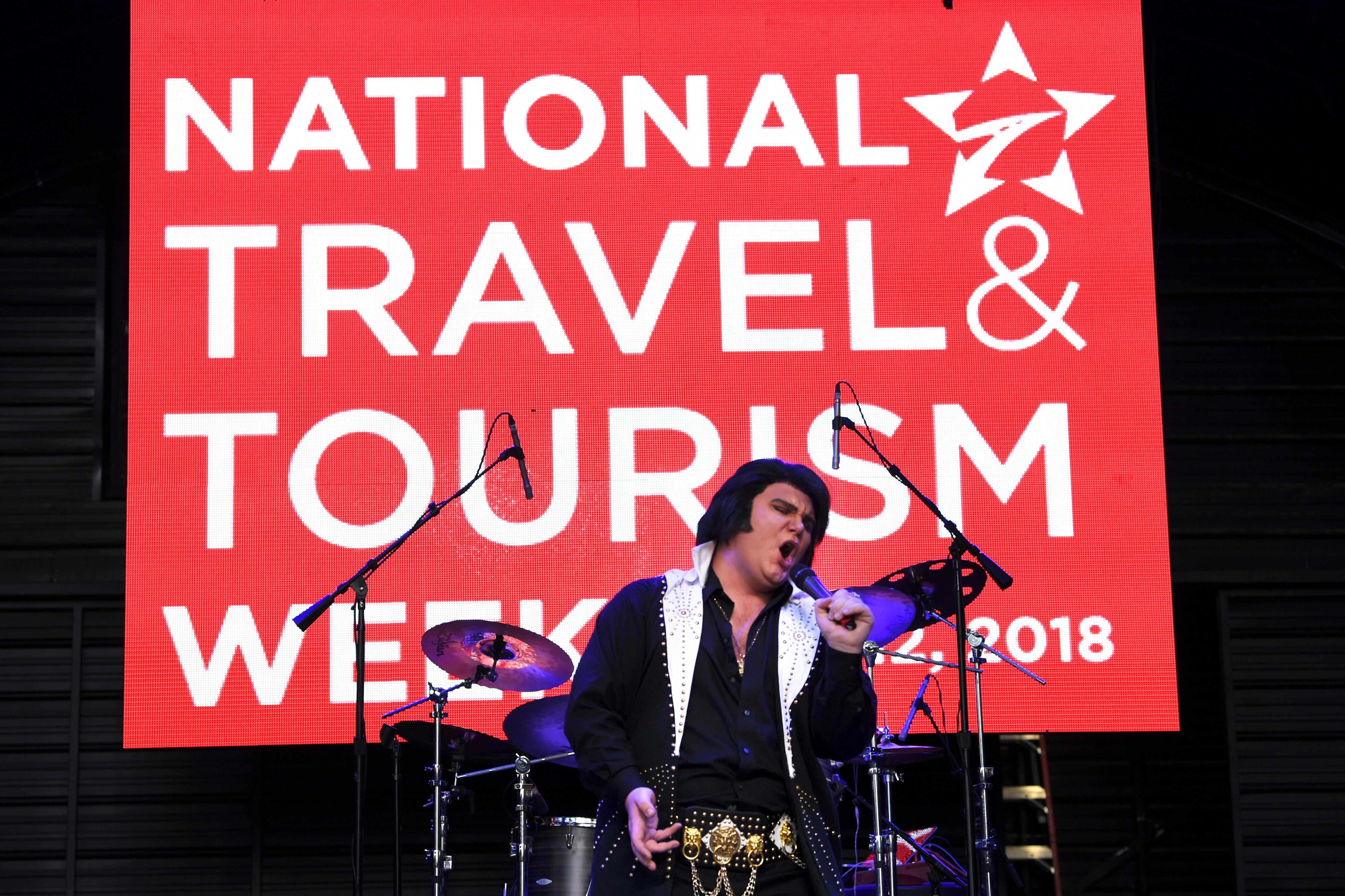 Elvis tribute artist Tyler James performs as part of National Travel and Tourism Week Tuesday, May 8, 2018, at the Fremont Street Experience in downtown Las Vegas. CREDIT: Sam Morris/Las Vegas News Bureau