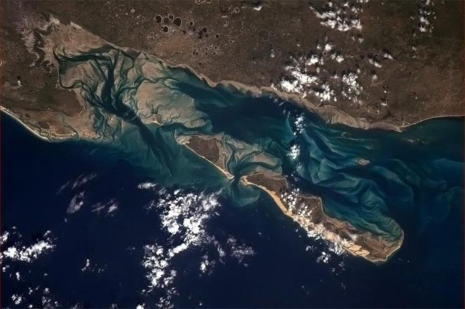 Sand and water playing hide and seek on the African east coast. (Photo & Caption: Col. Chris Hadfield, NASA)