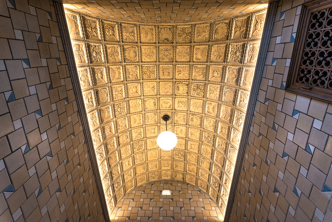 One of the entrances has a vaulted ceiling inlaid with beautiful one-of-a-kind tile. The light fixture is original to the building, though not to that space (it was repurposed from another part of the building). / Image: Phil Armstrong, Cincinnati Refined // Published: 1.26.19