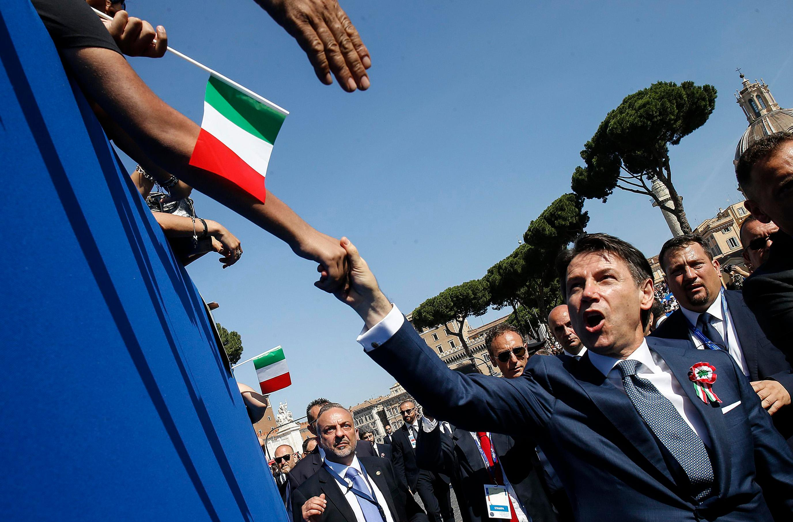 Italian Premier Giuseppe Conte is greeted by citizens on the occasion of the celebrations for Italy's Republic Day, in Rome Saturday, June 2, 2018. (Fabio Frustaci/ANSA via AP)