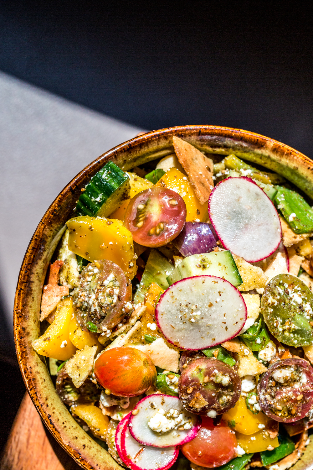 Fattoush 2.0: yellow peppers, radish, tomato, scallion, cucumber, za'atar, warm pita, cheese, and lemon / Image: Catherine Viox // Published: 9.30.19
