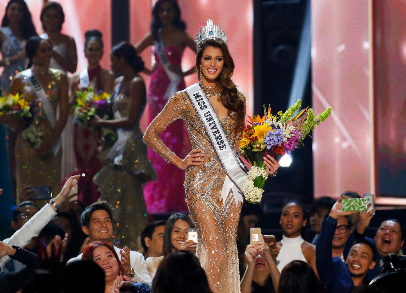 Iris Mittenaere of France reacts shortly after being proclaimed the new Miss Universe 2016 in coronation Monday, Jan. 30, 2017, at the Mall of Asia in suburban Pasay city, south of Manila, Philippines. (AP Photo/Bullit Marquez)