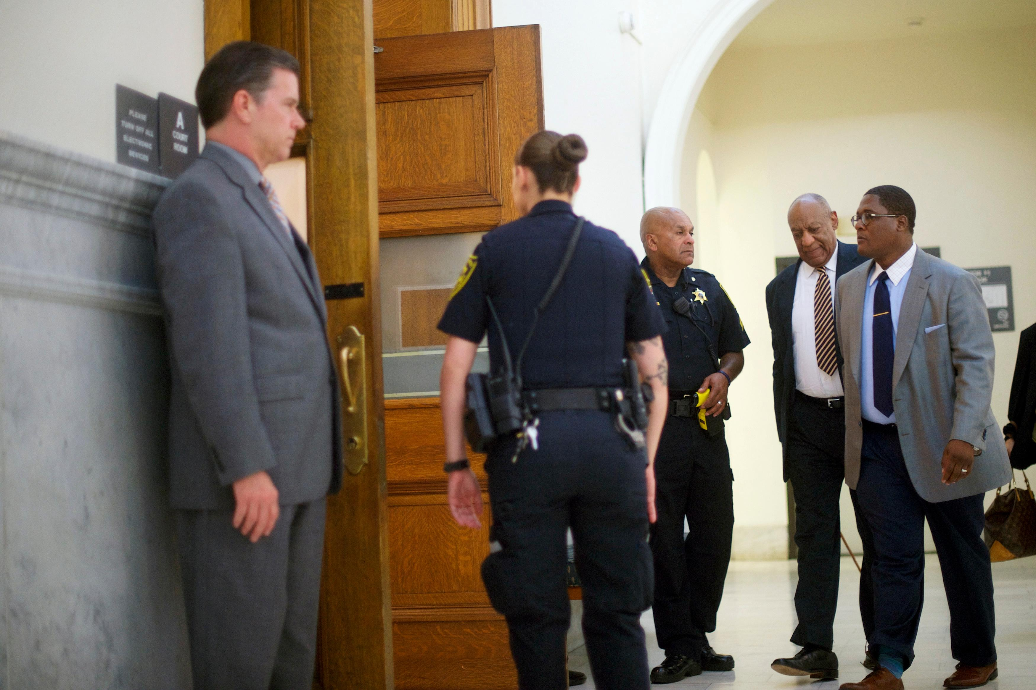 Bill Cosby enters the courtroom during his sexual assault trial at the Montgomery County Courthouse in Norristown, Pa., Wednesday, June 14, 2017. (Mark Makela/Pool Photo via AP)
