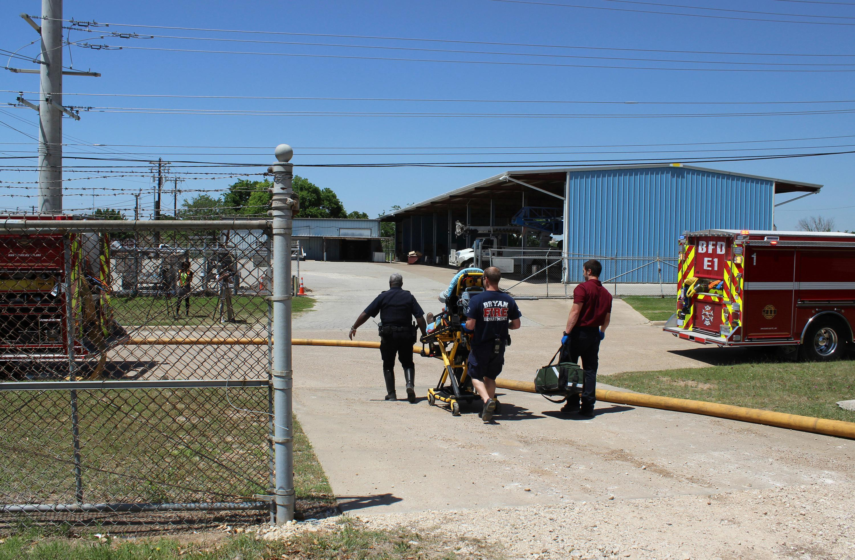 In this photo provide by the Bryan, Texas Fire Department, taken April 29, 2014, Bryan Texas firefighters transport injured worker in a stretcher to the ambulance. An explosion at the Bryan Texas Utilities Power Plant left a 60-year-old employee dead and two injured. Earle Robinson, 60, and other employees were doing maintenance work at Bryan Texas Utilities Power Plant, about 100 miles north of Houston, when there was a loud explosion. Workers called 911 and pleaded for help. Older people are dying on the job at a higher rate than workers overall, even as the rate of workplace fatalities decreases, according to an Associated Press analysis of federal statistics. (Bryan, Texas Fire Department via AP)