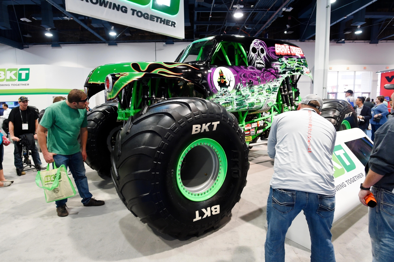A monster truck is examined in the BKT Tire booth during the first day of the 2017 CONEXPO-CON/AGG convention Tuesday, March 7, 2017, at the Las Vegas Convention Center. [Sam Morris/Las Vegas News Bureau]