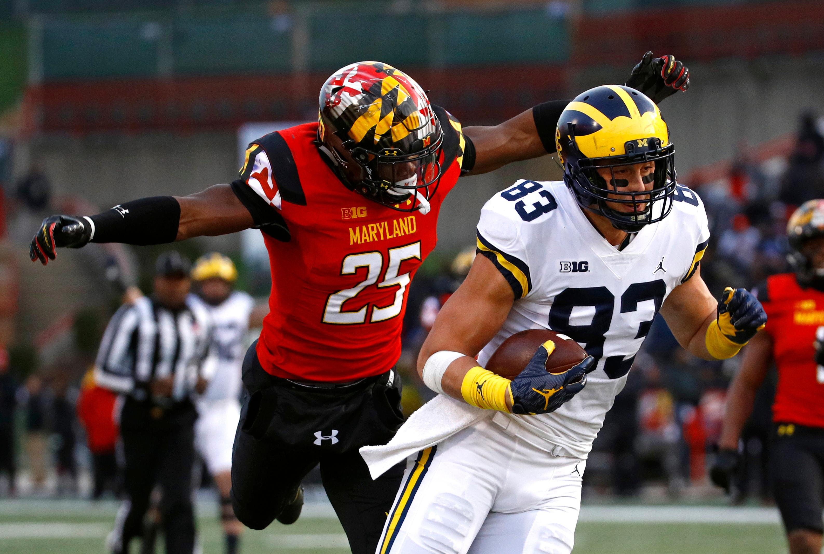 Michigan tight end Zach Gentry, right, rushes past Maryland defensive back Antoine Brooks Jr. for a touchdown in the first half of an NCAA college football game in College Park, Md., Saturday, Nov. 11, 2017. (AP Photo/Patrick Semansky)