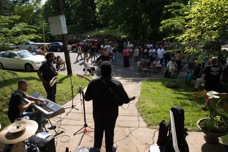 "The first SE Porchfest took place in the Hillcrest/Penn Branch community on Sunday, May 20 with 20 local artists representing all music genres from folk to reggae, hip-hop, rock and jazz. While other Porchfests, which are a series of mini concerts held on front porches, have been organized and supported by local BIDS, the SE Porchfest was run entirely by volunteers. ""The goal [was] to promote the beauty and talent in our community,"" said SE Porchfest organizer, Ayanna Smith. ""There's a negative stigma associated with living East of the River that is partially based on stereotypes. We're hoping that Porchfest provide[s] an opportunity to spotlight our wonderful community and dispel some of the myths that exist."" (Image: Jeff Martin/ DC Refined)"
