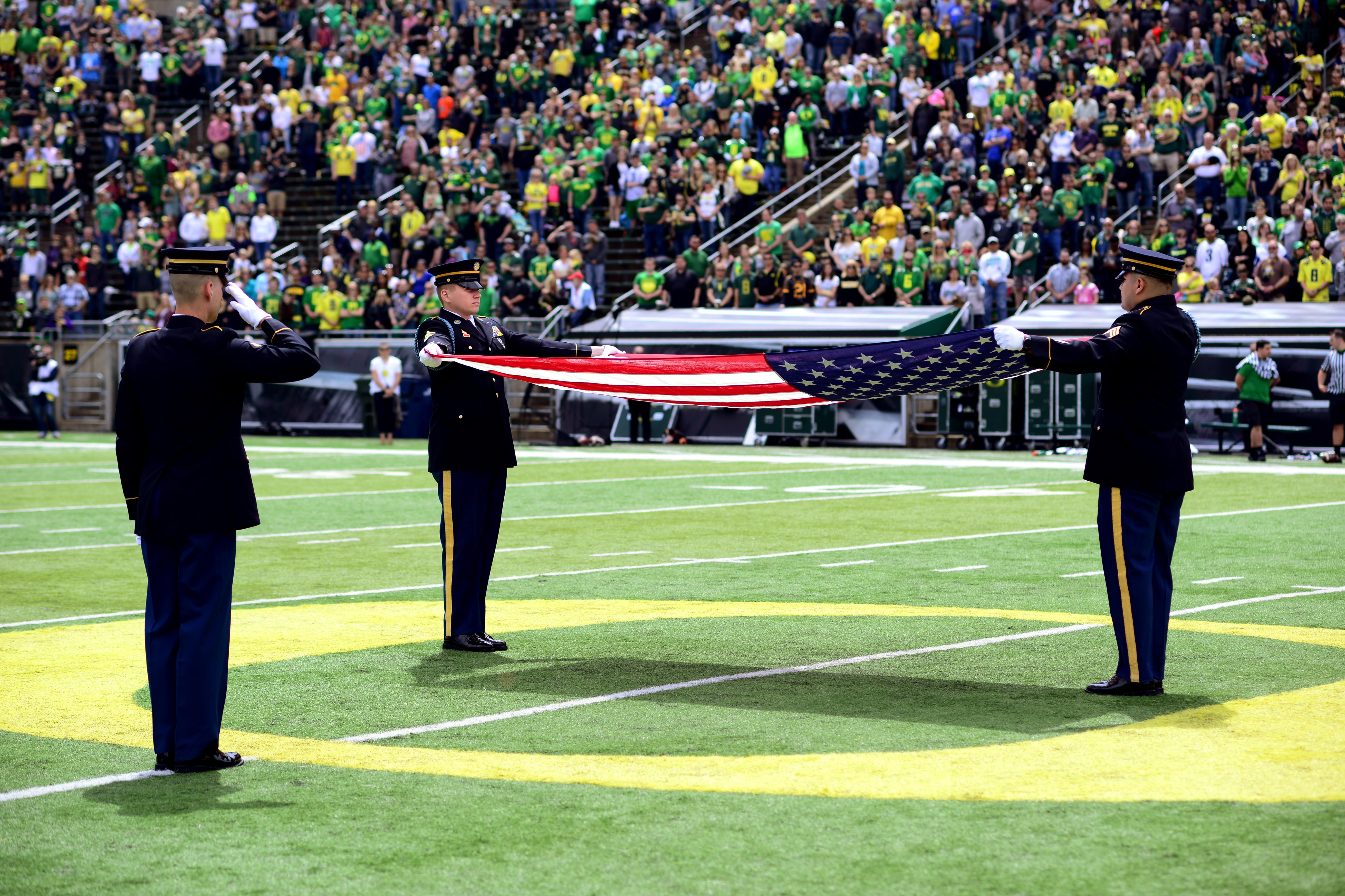 Oregon National Guard Soldiers perform a flag folding ceremony in honor of missing and fallen service members during half time at the University of Oregon Spring Game, April 29, 2017, at Autzen Stadium in Eugene, Oregon. Members of the Oregon National Guard, along with Veterans from every branch of service, participated in Military Appreciation Day activities during the game. (Photo by Sgt. 1st Class April Davis, Oregon Military Department Public Affairs)