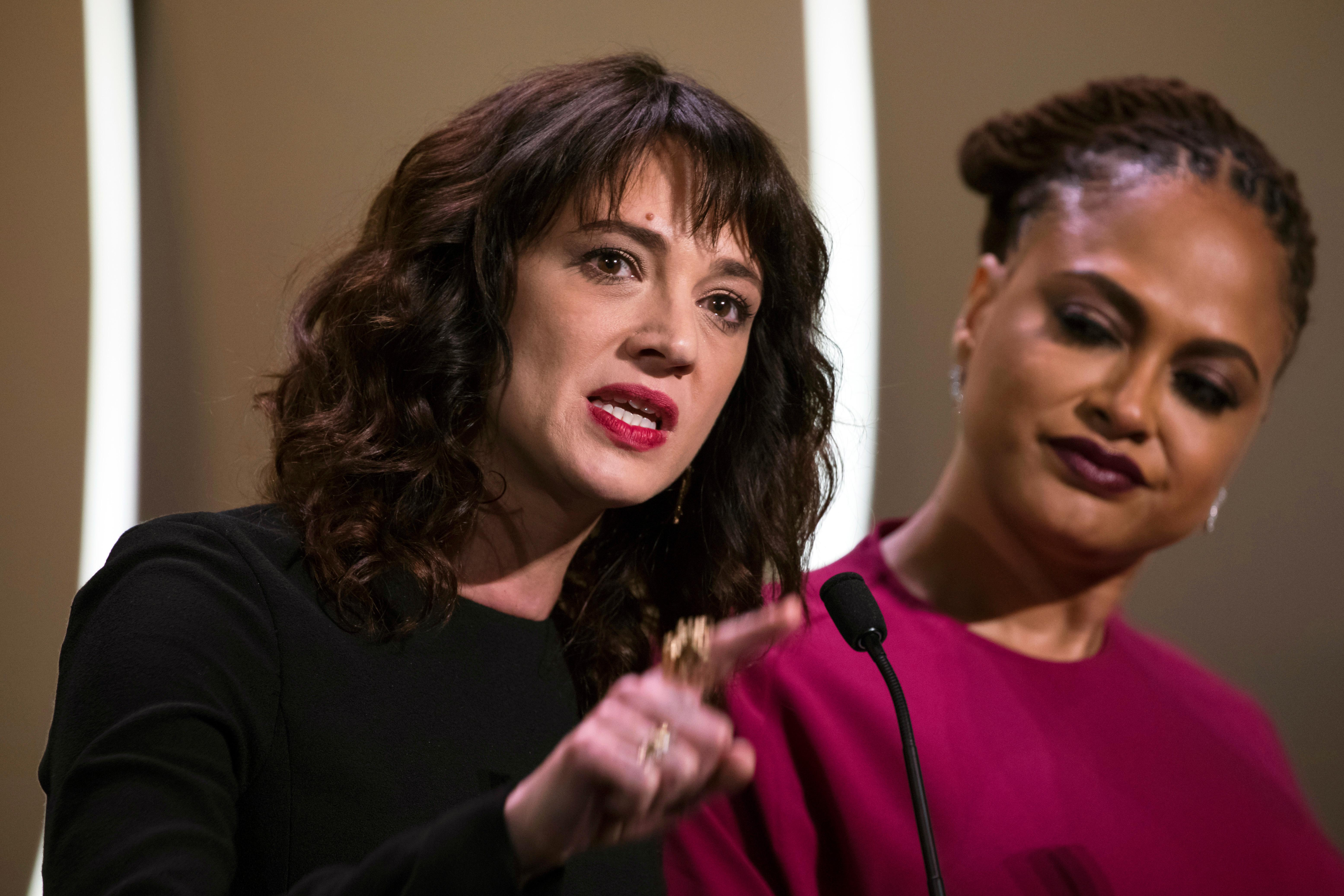 FILE - In this May 19, 2018 file photo, actress Asia Argento speaks about being raped by Harvey Weinstein as director Ava Duvernay looks on at right during the closing ceremony of the 71st international film festival, Cannes, in France. Argento, one of the most prominent activists of the #MeToo movement against sexual harassment, recently settled a complaint filed against her by a young actor and musician who said she sexually assaulted him when he was 17, the New York Times reported. (Photo by Vianney Le Caer/Invision/AP, File)