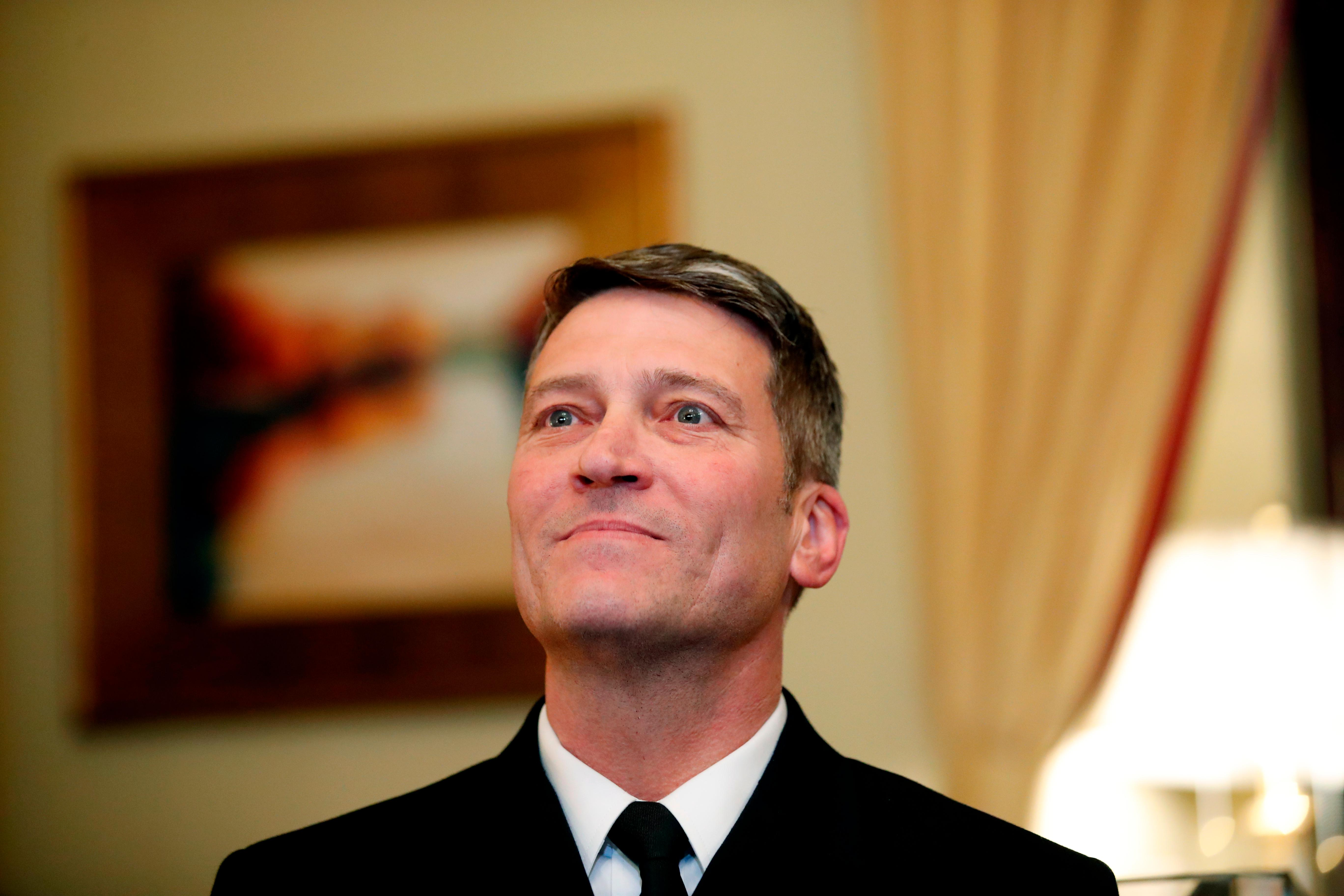 In this April 16, 2018, photo, U.S. Navy Rear Adm. Ronny Jackson, M.D., sits with Sen. Johnny Isakson, R-Ga., chairman of the Veteran's Affairs Committee, before their meeting on Capitol Hilin Washington. Jackson is President Donald Trump's nominee to be the next Secretary of Veterans Affairs. Now it's Washington's turn to examine Jackson. The doctor to Presidents George W. Bush, Barack Obama and now Donald Trump is an Iraq War veteran nominated to head the Department of Veterans Affairs. (AP Photo/Alex Brandon)