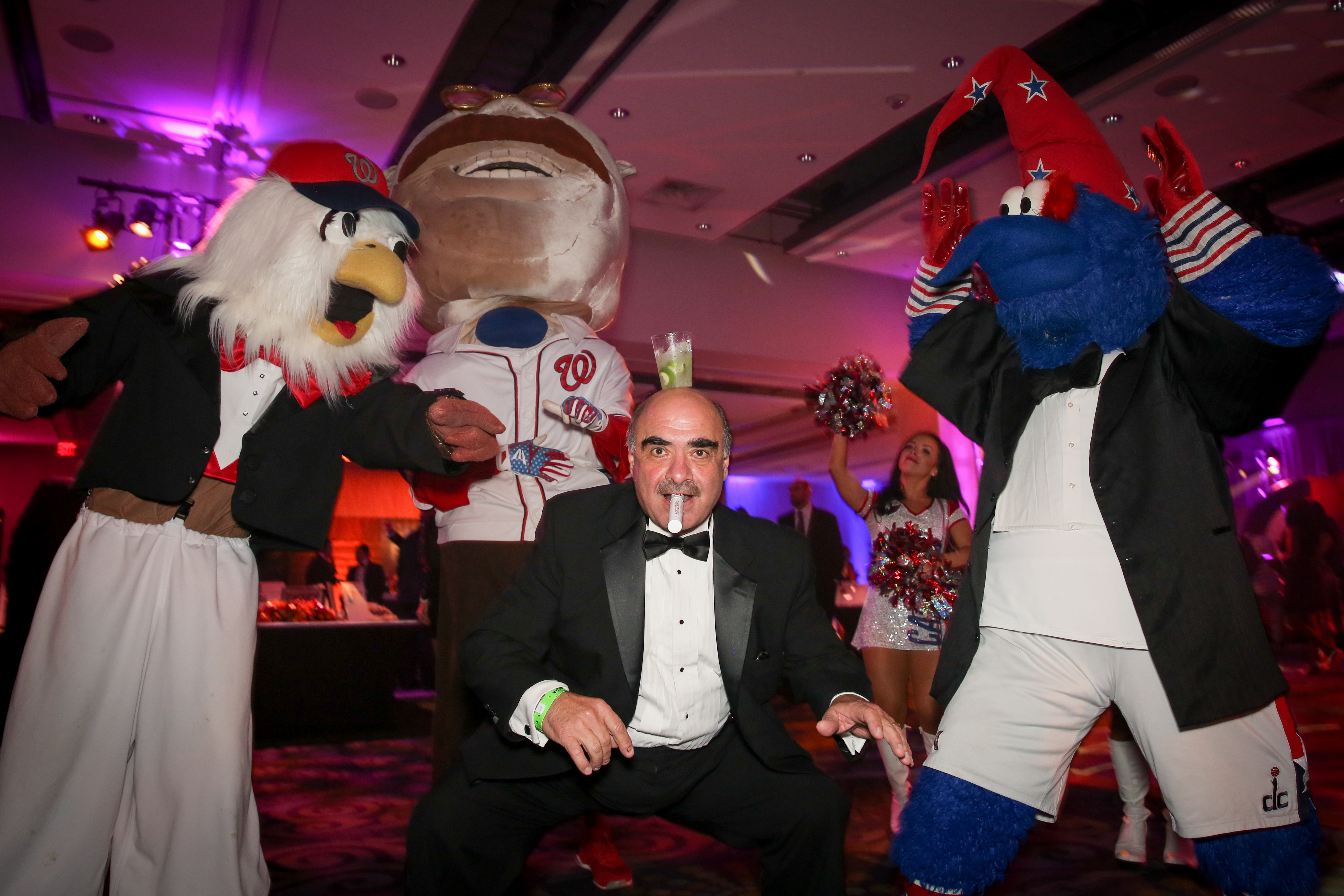 Mike Ghanem dances with DC mascots. (Amanda Andrade-Rhoades/DC Refined)<p></p>