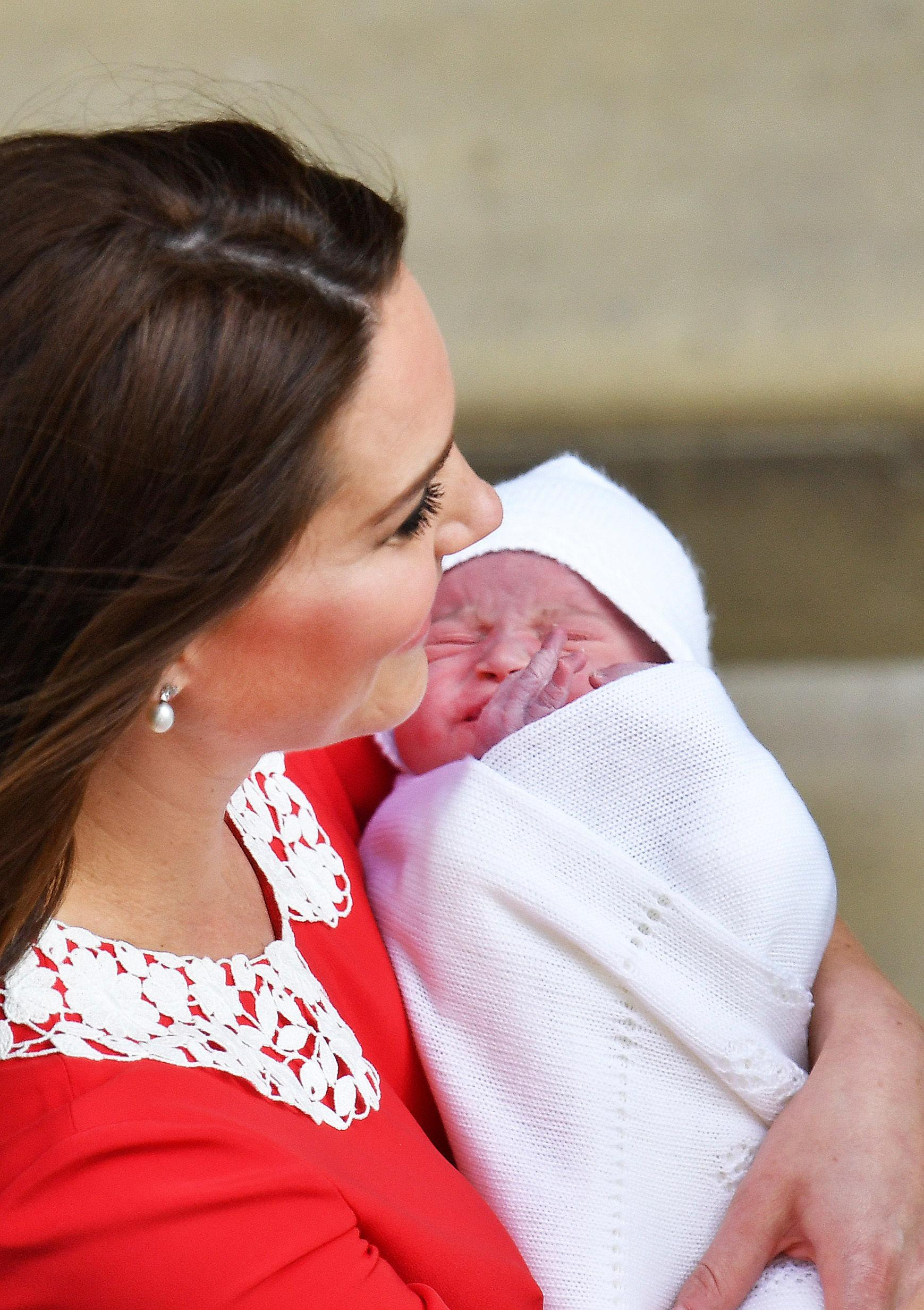 Kate, Duchess of Cambridge with their newborn baby son as they leave the Lindo wing at St Mary's Hospital in London London, Monday, April 23, 2018. The Duchess of Cambridge gave birth Monday to a healthy baby boy — a third child for Kate and Prince William and fifth in line to the British throne. (John Stillwell/Pool photo via AP)