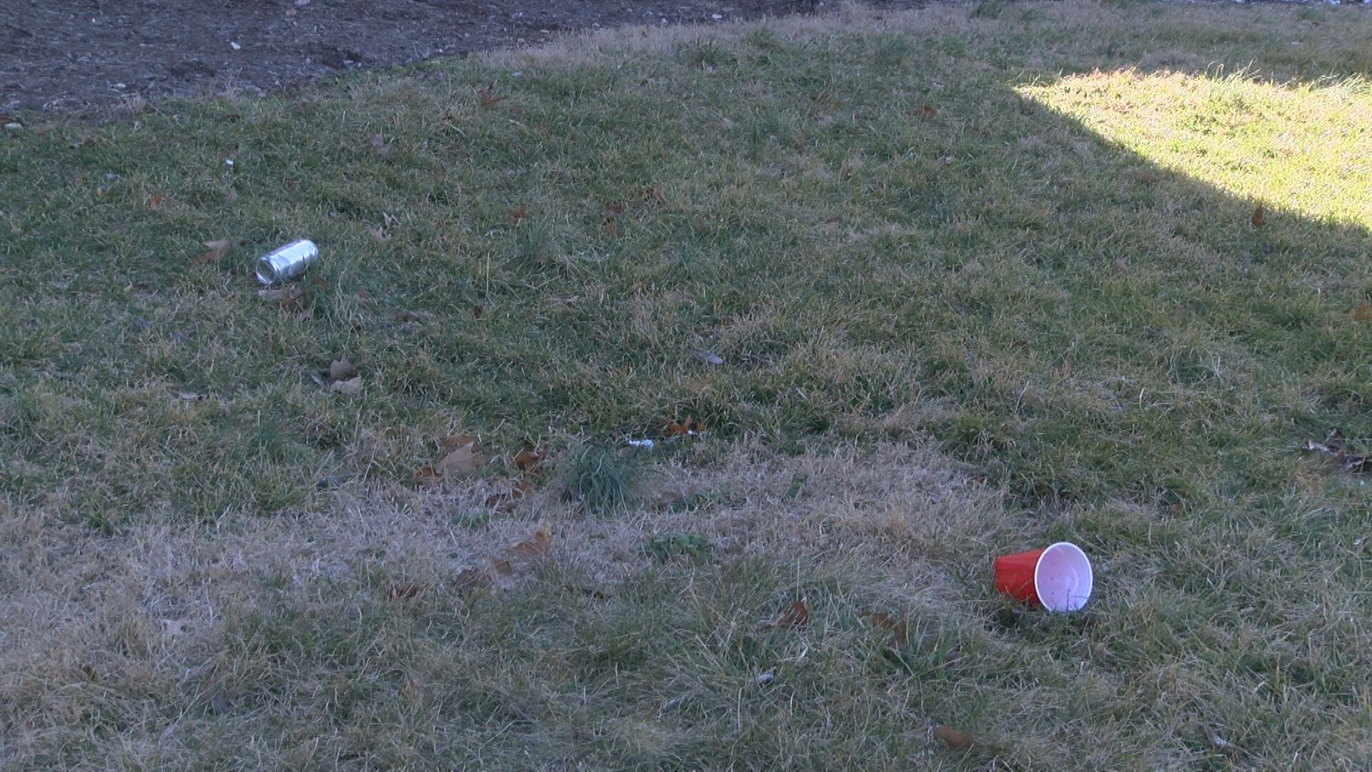 A beer can lays on the lawn of the Sigma Alpha Epsilon house at ETSU. (Thomas Gray/WCYB)