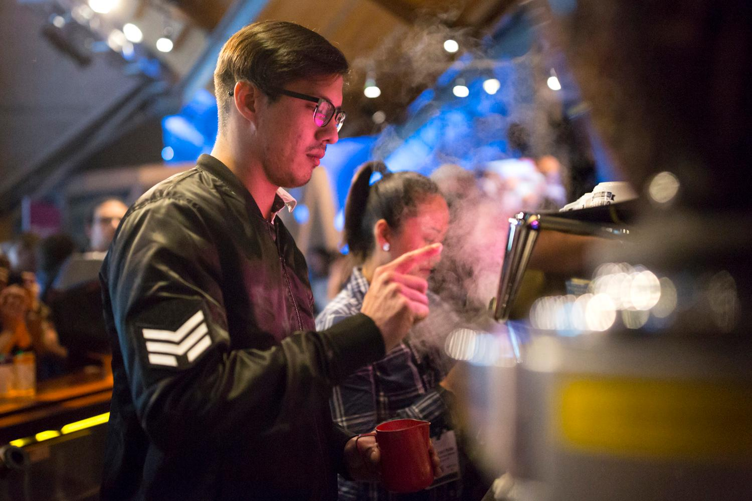 The 2018 US Coffee Championship kicked off Thursday night with the Latte Art Throwdown at MoPOP. Competitors had to use a UNIC Stella 2 Group coffee machine, a UNIC grinder, and Pacific Foods Non-Dairy Beverages for the milk. The winner took home a brand new machine, grinder, and temperature controlled thermos. (Sy Bean / Seattle Refined)