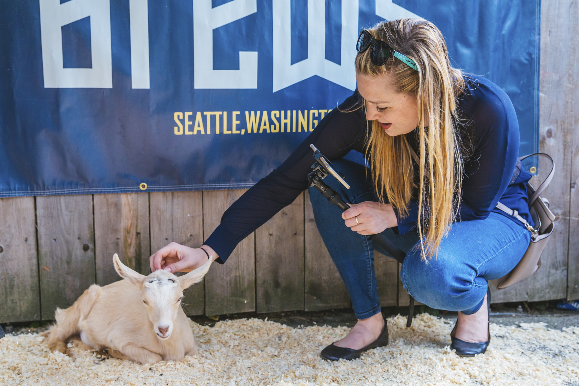 Attendees sip craft beer and pet baby rescue goats at the third annual Baby Goats and Brews fundraiser at Reuben's Brews in Ballard. $1 from every beer, growler, and flight sold goes to Puget Sound Goat Rescue. (Sunita Martini / Seattle Refined)