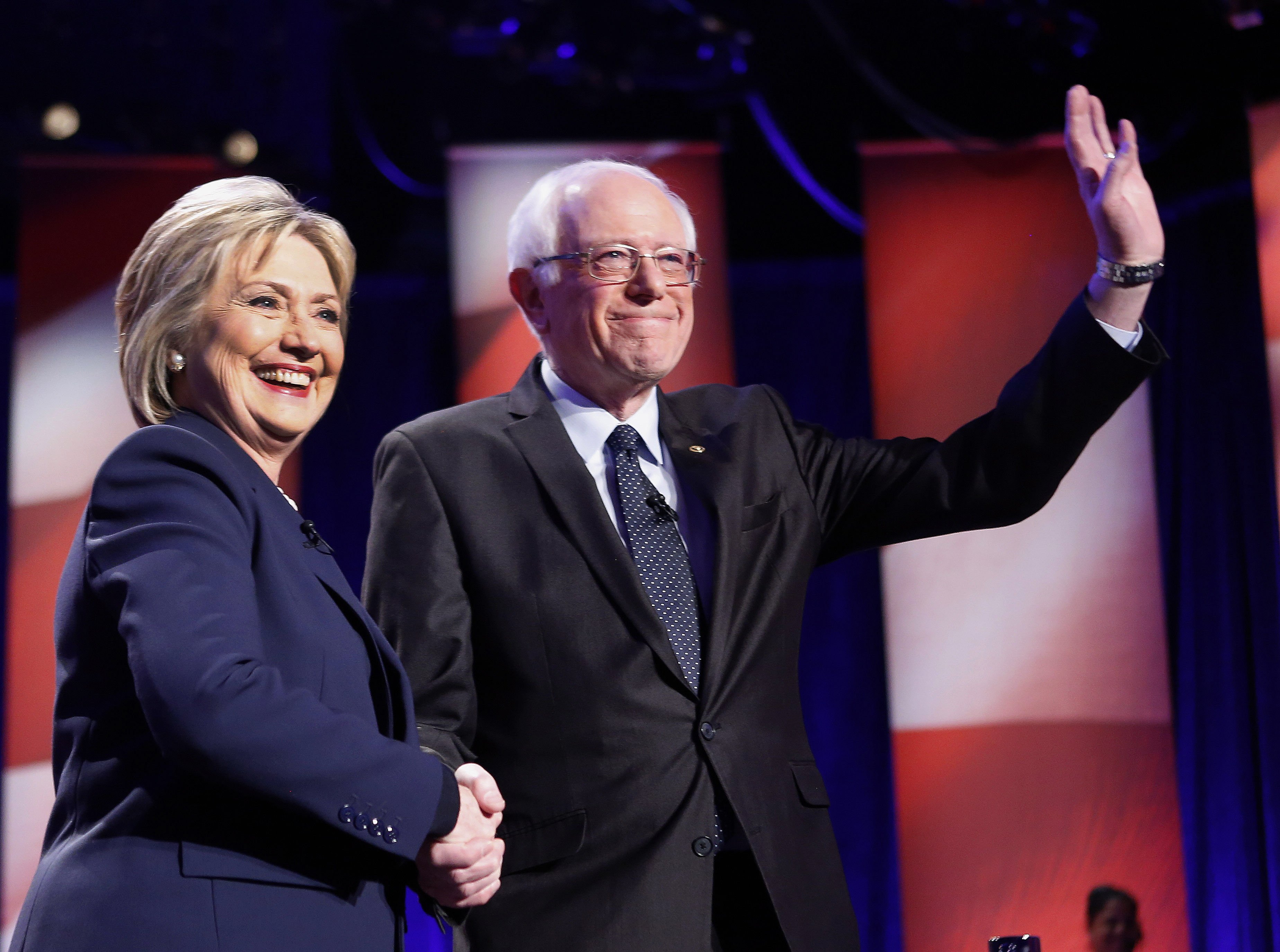 Democratic presidential candidates Hillary Clinton, left, and Sen. Bernie Sanders, I-Vt, pose for a photo before debating at the University of New Hampshire Thursday, Feb. 4, 2016, in Durham, N.H. (AP Photo/Jim Cole)
