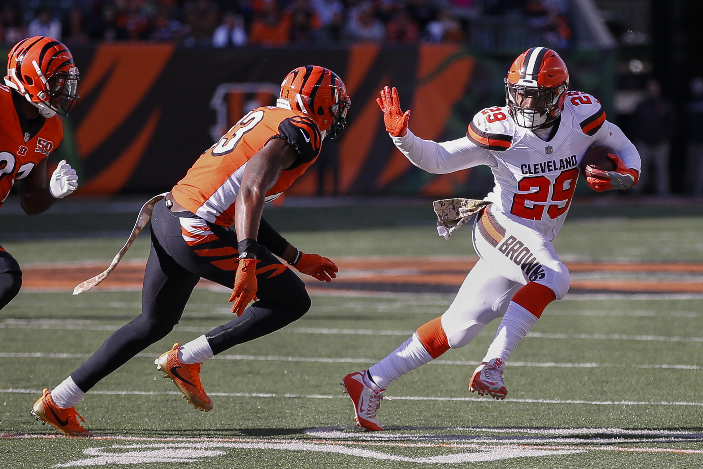 Cleveland Browns running back Duke Johnson (29) runs the ball against Cincinnati Bengals free safety George Iloka (43) in the first half of an NFL football game, Sunday, Nov. 26, 2017, in Cincinnati. (AP Photo/Gary Landers)