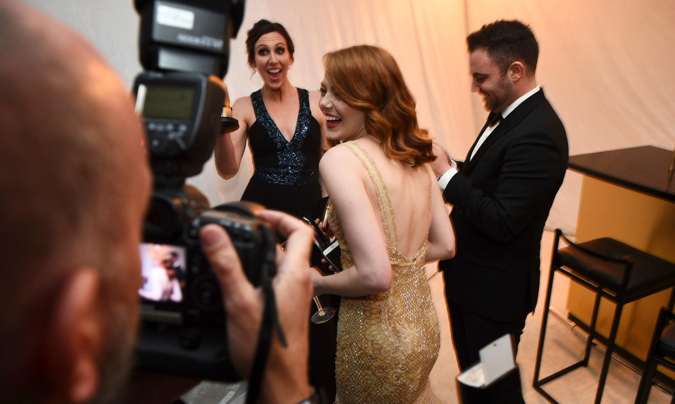 "Emma Stone poses the award winner for best actress in a leading role for ""La La Land attends the Governors Ball after the Oscars on Sunday, Feb. 26, 2017, at the Dolby Theatre in Los Angeles. (Photo by Al Powers/Invision/AP)"