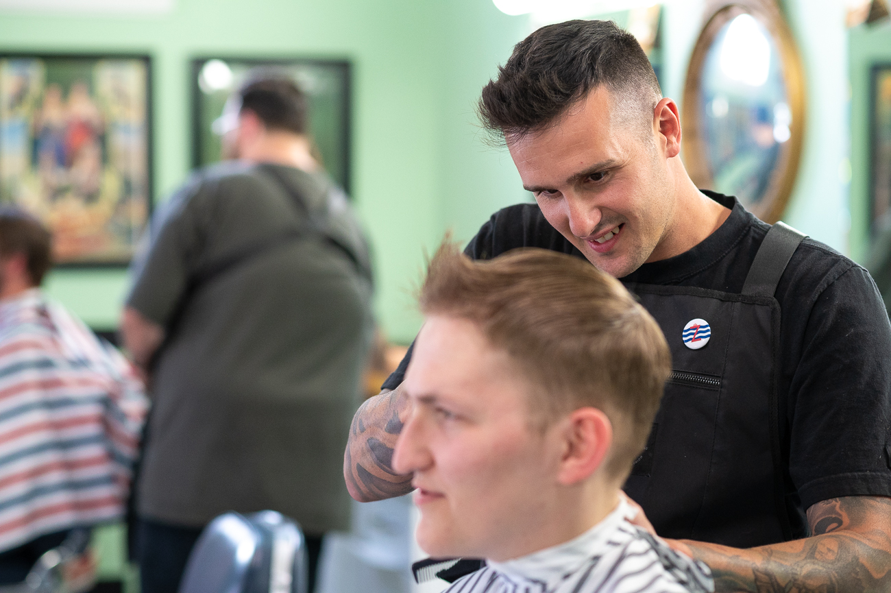 """The barbershop means being part of the community and helping one another,"" Seth Kirby, known simply as Kirby in the shop, says. ""It's a strong team unit just to come together and make the community a better place."" / Image: Phil Armstrong, Cincinnati Refined // Published: 7.10.20"