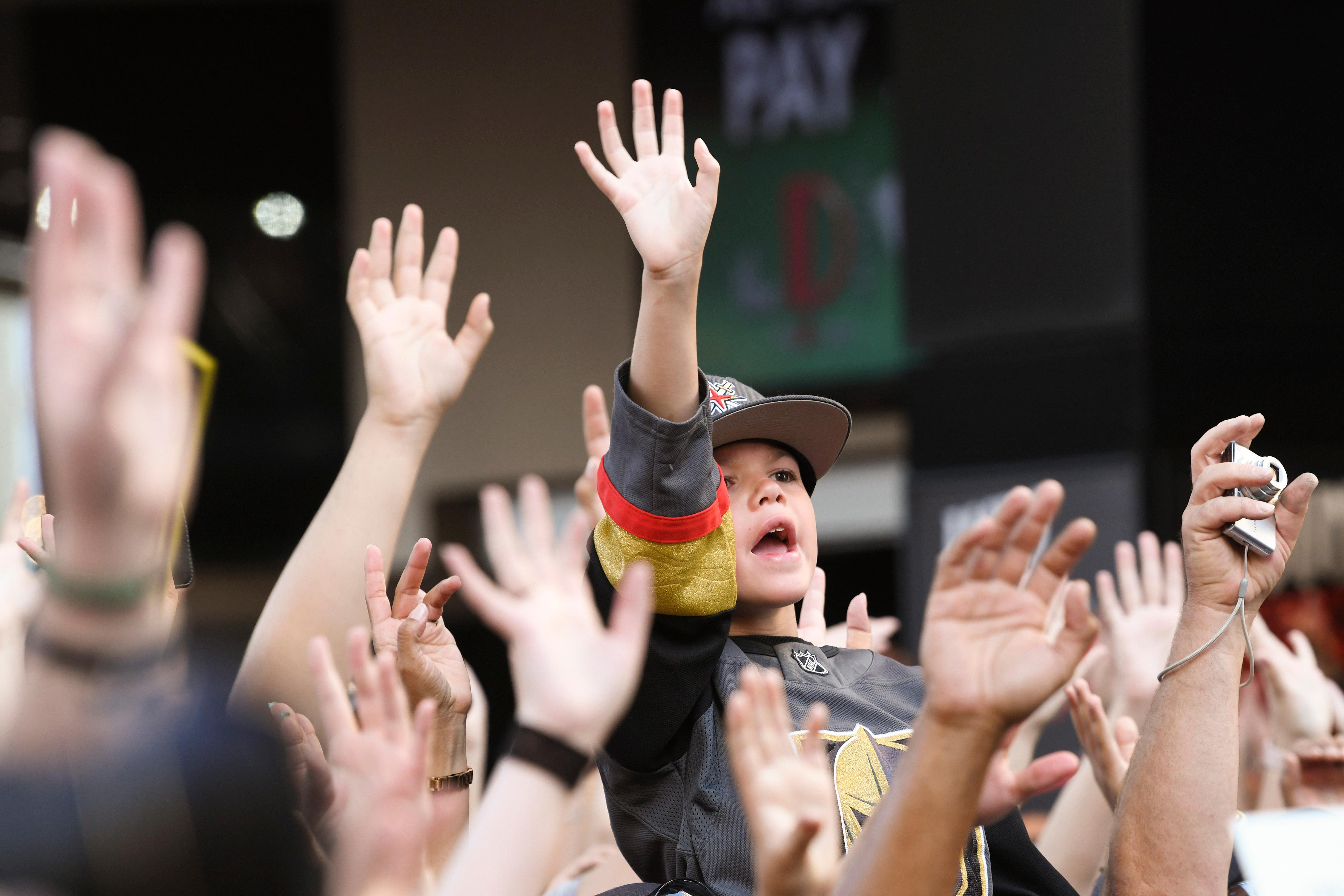 "A young fan waves during a Vegas Golden Knights ""Stick Salute to Vegas"" fan appreciation rally at the Fremont Street Experience Wednesday, June 13, 2018. CREDIT: Sam Morris/Las Vegas News Bureau"