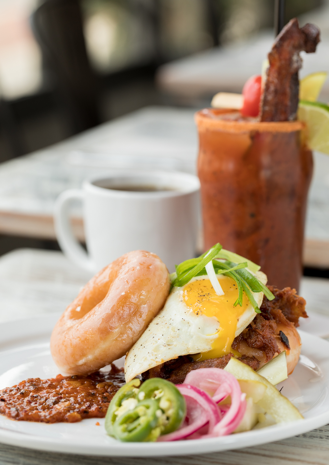 Smoked Pork & Donuts: Eli's BBQ smoked pork, a Krispy Kreme, and a fried egg with the house Bloody Mary to drink / Image: Marlene Rounds // Published: 1.6.19