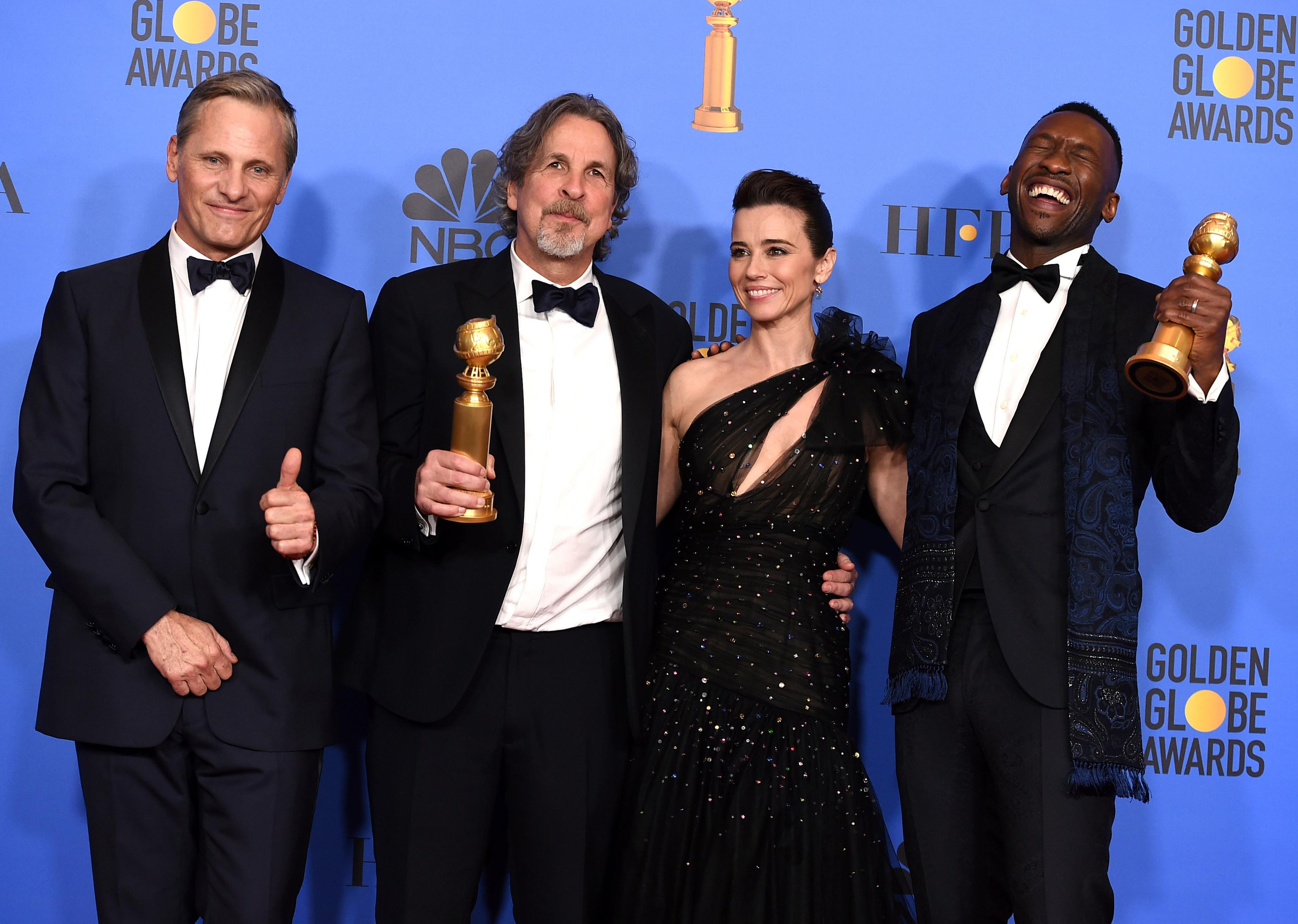 Viggo Mortensen, from left, Peter Farrelly, Linda Cardellini and Mahershala Ali,{ } at the 76th annual Golden Globe Awards at the Beverly Hilton Hotel on Sunday, Jan. 6, 2019, in Beverly Hills, Calif. (Photo by Jordan Strauss/Invision/AP)
