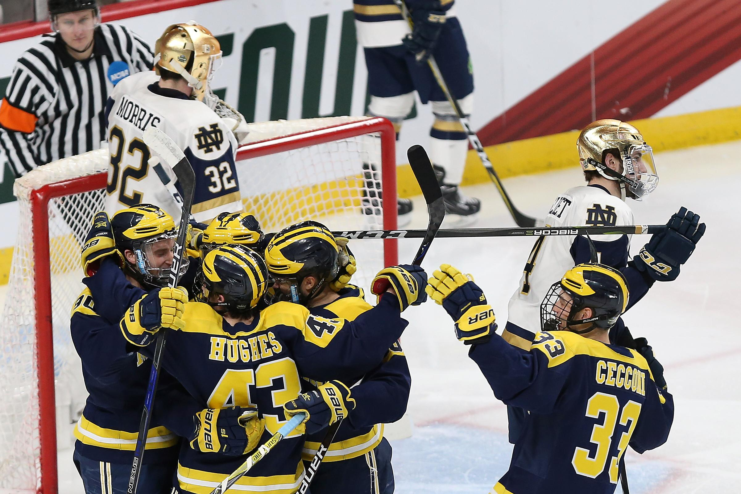 Michigan players celebrate on ice after scoring a goal during the second period of a semifinal in the NCAA men's Frozen Four hockey tournament against Notre Dame, Thursday, April 5, 2018, in St. Paul, Minn. (AP Photo/Stacy Bengs)