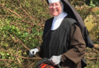 Nun cutting a tree.PNG