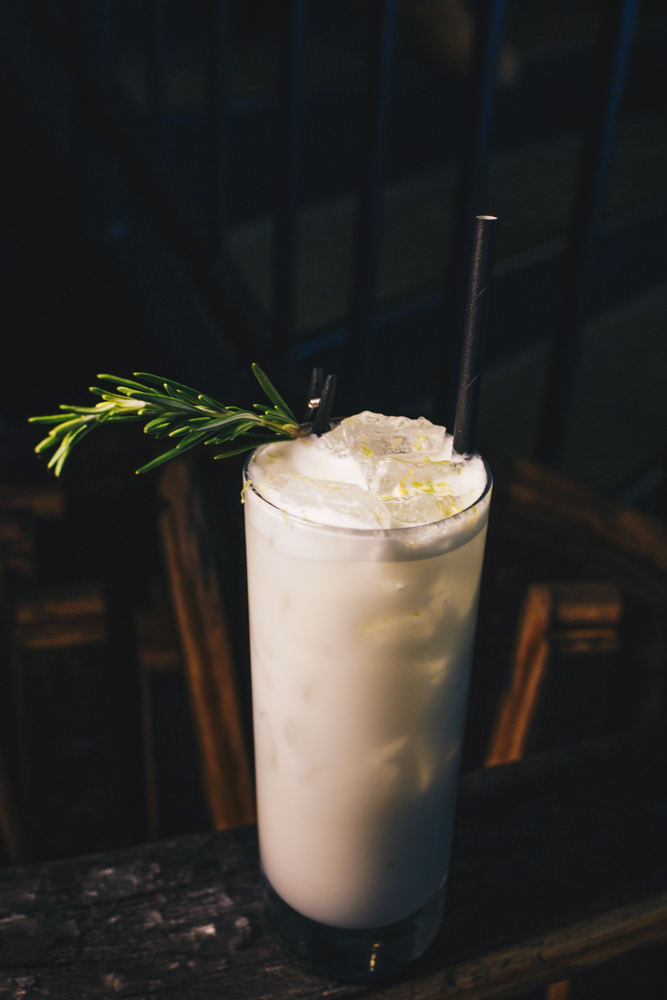 Nights in White Satin: New Riff BBA Kentucky Wild Gin, heavy cream, orgeat, lemon, lime, egg white, club soda, and garnished with fresh rosemary and lemon & lime zest / Image: Catherine Viox // Published: 3.25.19