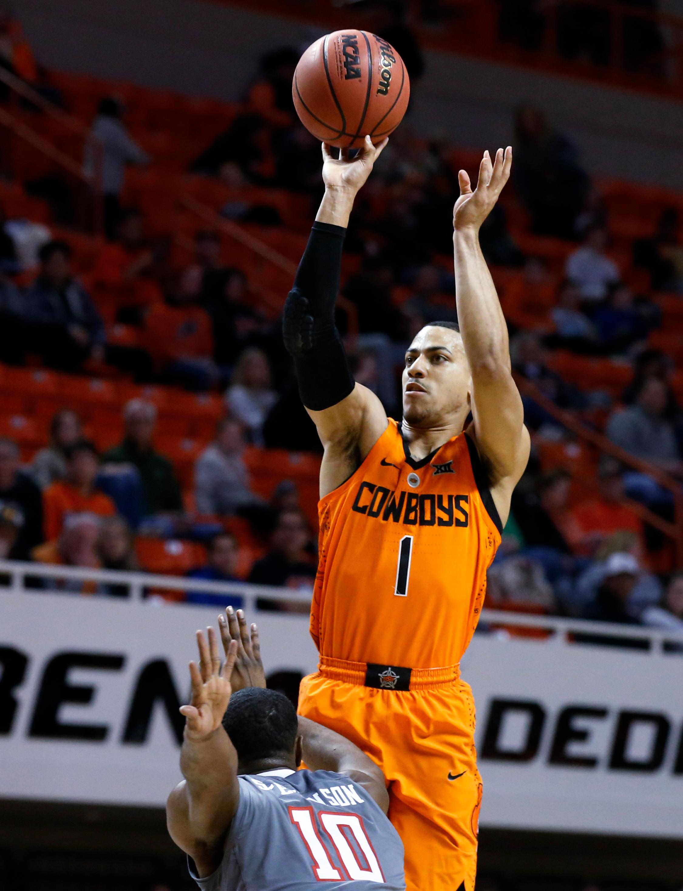 Oklahoma State guard Kendall Smith (1) shoots over Texas Tech guard Niem Stevenson (10) during the first half of an NCAA college basketball game in Stillwater, Okla., Wednesday, Feb. 21, 2018. (AP Photo/Sue Ogrocki)
