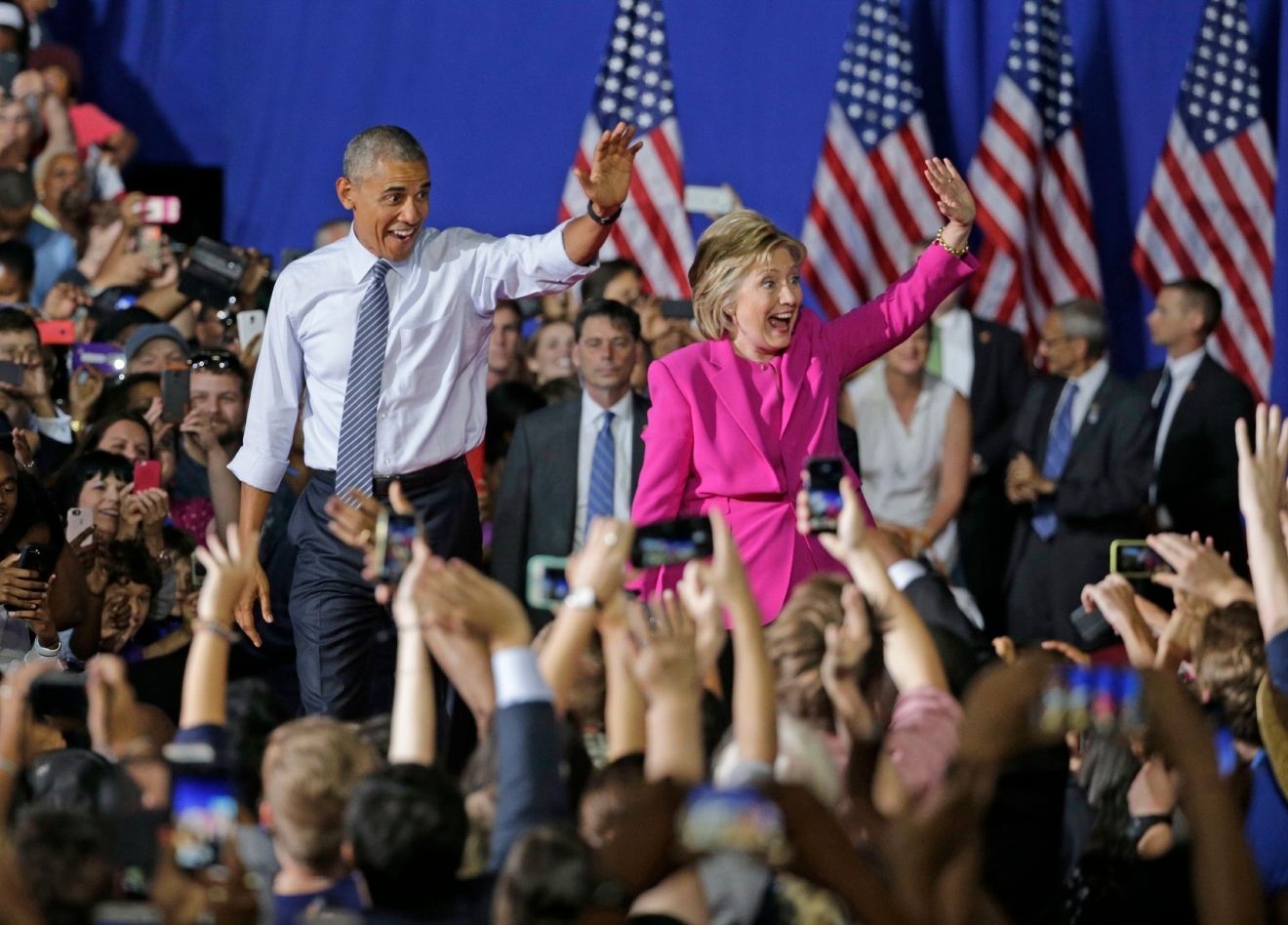 President Barack Obama and Democratic presidential candidate Hillary Clinton wave to the crowd during a campaign rally for Clinton in Charlotte, N.C., Tuesday, July 5, 2016. (AP Photo/Chuck Burton)
