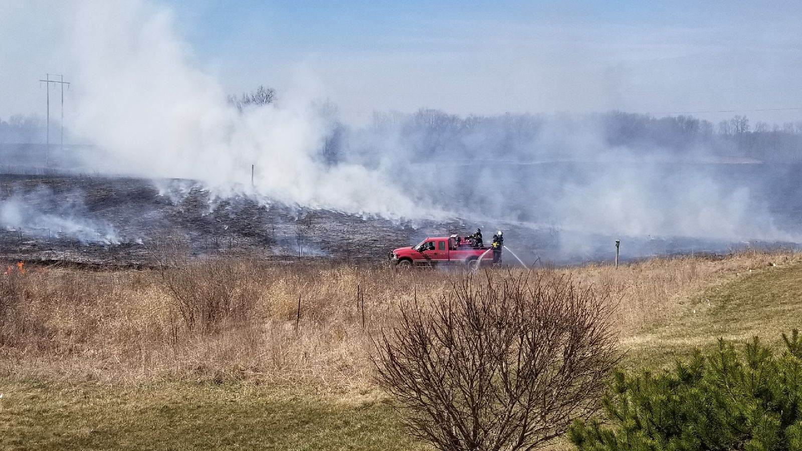 According to Marshall Township fire chief, a controlled burn that got out of hand due to wind conditions at 14693 L Drive North has now burned upwards of 25 acres. Although the fire is mostly under control now, fire officials are still working to get it under control. (Mike Savola)