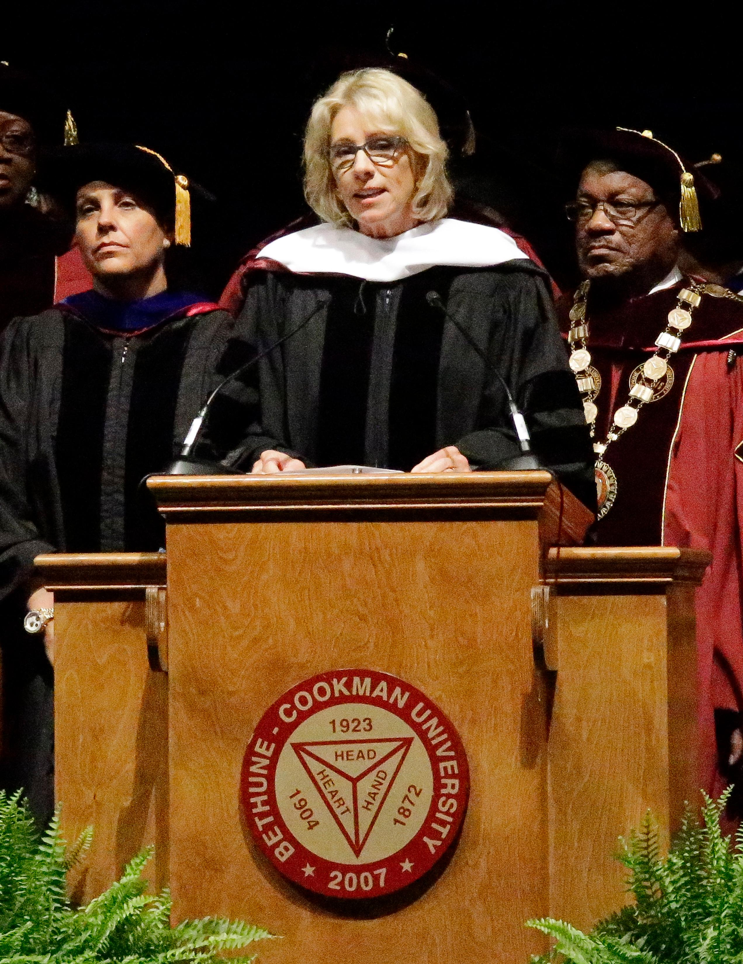 United States Secretary of Education Betsy DeVos delivers a commencement speech to graduates at Bethune-Cookman University, Wednesday, May 10, 2017, in Daytona Beach, Fla. (AP Photo/John Raoux)