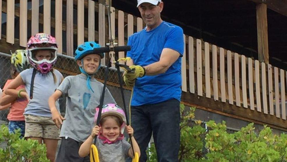 Doug with grandkids on zipline.JPG