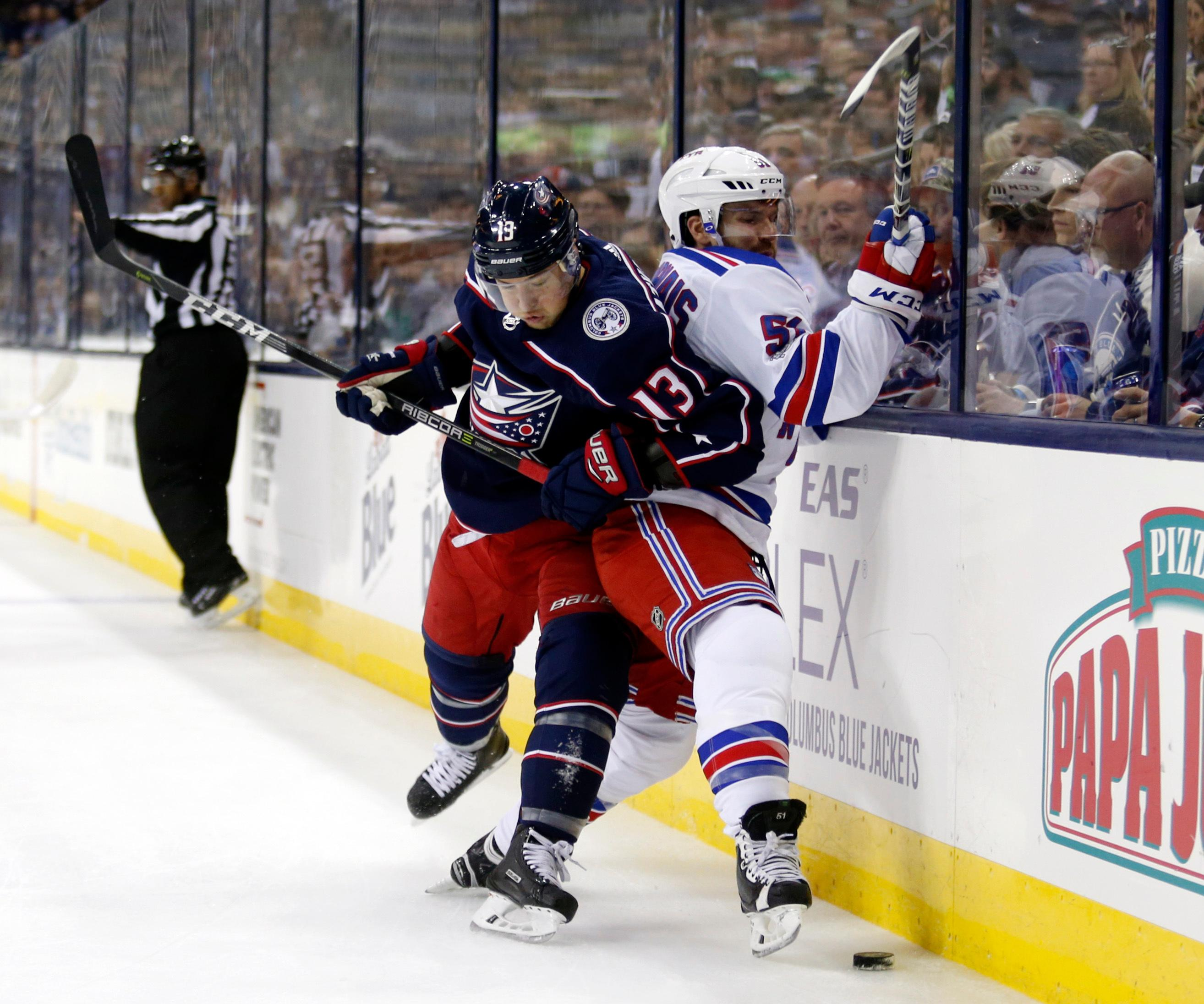 Columbus Blue Jackets forward Cam Atkinson, left, checks New York Rangers forward David Desharnais during the first period of an NHL hockey game in Columbus, Ohio, Friday, Oct. 13, 2017. (AP Photo/Paul Vernon)