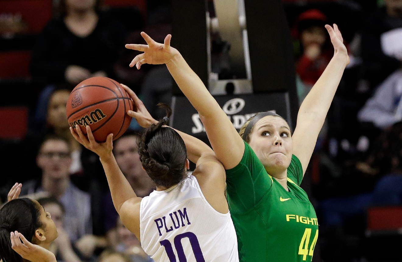 Oregon's Mallory McGwire, right, tries to block a shot by Washington's Kelsey Plum during the first half of an NCAA college basketball game in the Pac-12 tournament, Friday, March 3, 2017, in Seattle. (AP Photo/Elaine Thompson)