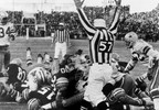Green Bay Packers quarterback Bart Starr (#15 at left) digs his face across the goal line to score the winning touchdown in the NFL Championship Game, Dec. 31, 1967, at Lambeau Field.