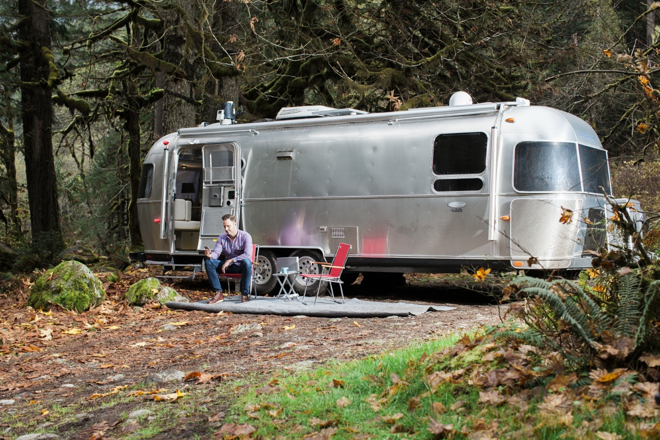 Seattle's own Chris Pendl bought an Airstream a few years ago as a second home to use in the great outdoors. With mainly products from Wink (an app for smart homes), he turned it into a pretty sweet wired mobile office complete with Wi-Fi and even a Vitamix! With a plethora of gadgets all accessible and maintainable through the Wink app , he's created his dream; a place to sleep that is modern and urban while still being surrounded by nature. (Image:  Darren Hendrix)