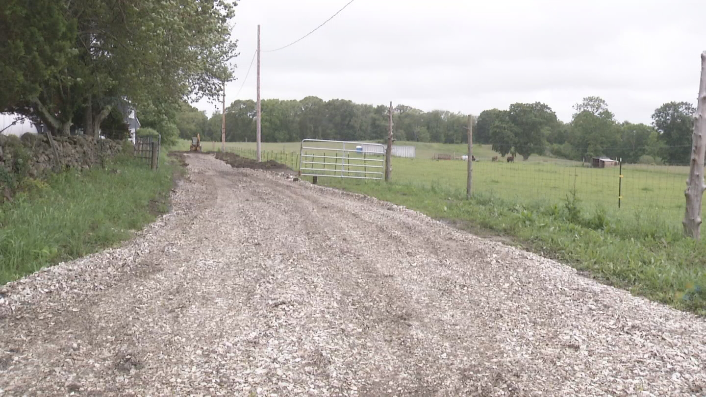 Tiverton residents say an access road made of clamshells has created a terrible stench. (WJAR)