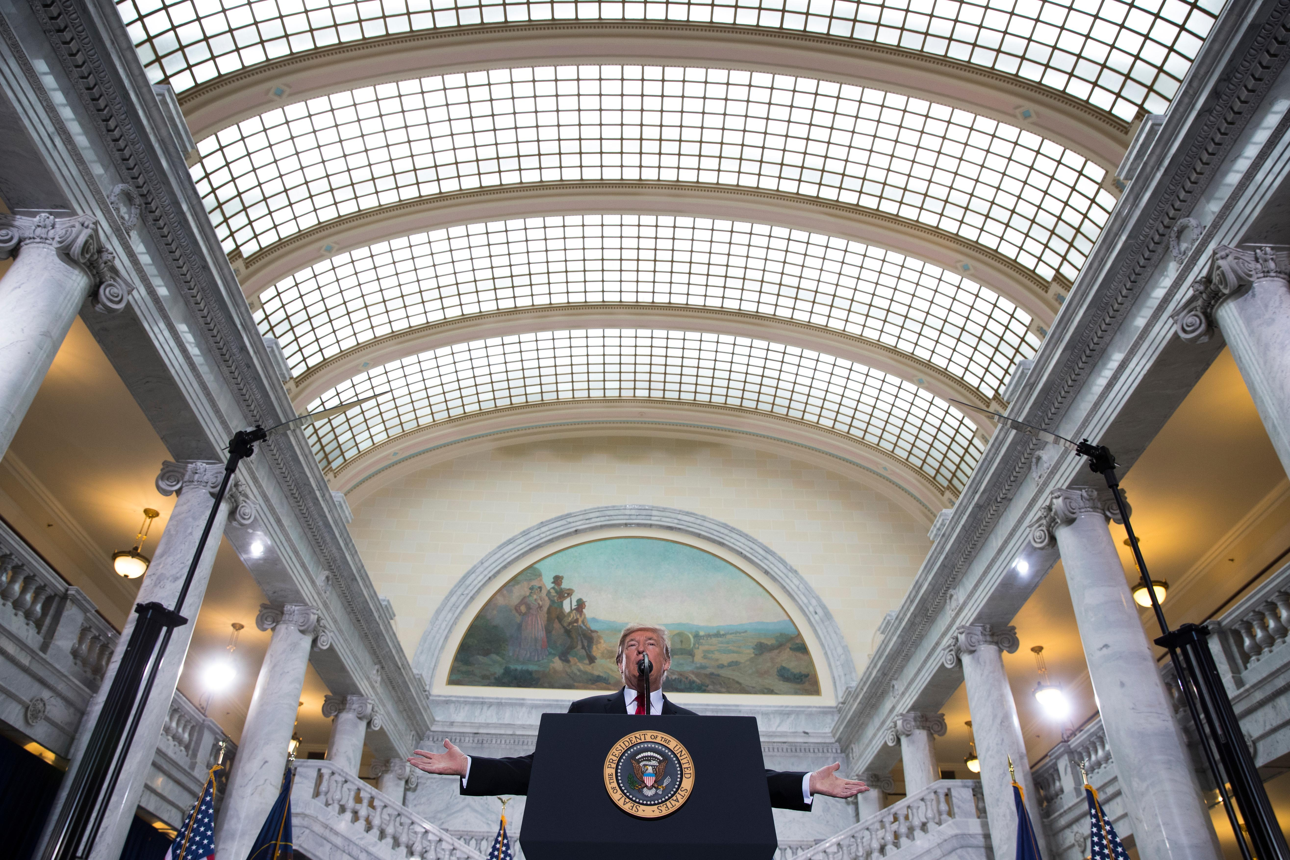 President Donald Trump speaks on his decision to shrink the size of Bears Ears and Grand Staircase Escalante national monuments, Monday, Dec. 4, 2017, in Salt Lake City. (AP Photo/Evan Vucci)
