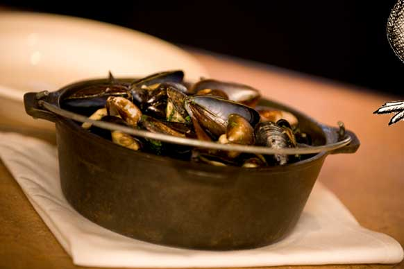 Penn Cove mussels are showcased at the Prima Bistro on Whidbey Island just down the road from Penn Cove. Served à la marinière (or of the sea), the mussels are added to a mixture of shallots, celery and garlic, butter and white wine. Served in a cast iron pot, more butter is added to the mussels once they are steamed open.  (Image: Prima Bistro)