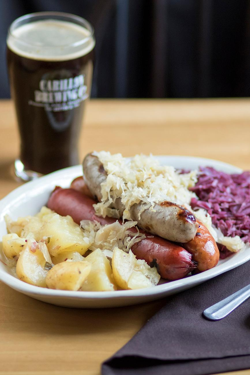 The menu offerings are as close to what would have been historically available in Dayton as possible. Shown here is the Wurst Platter with sweet and sour cabbage and German potato salad and Porter. / Image: Allison McAdams // Published: 1.16.18<p></p>