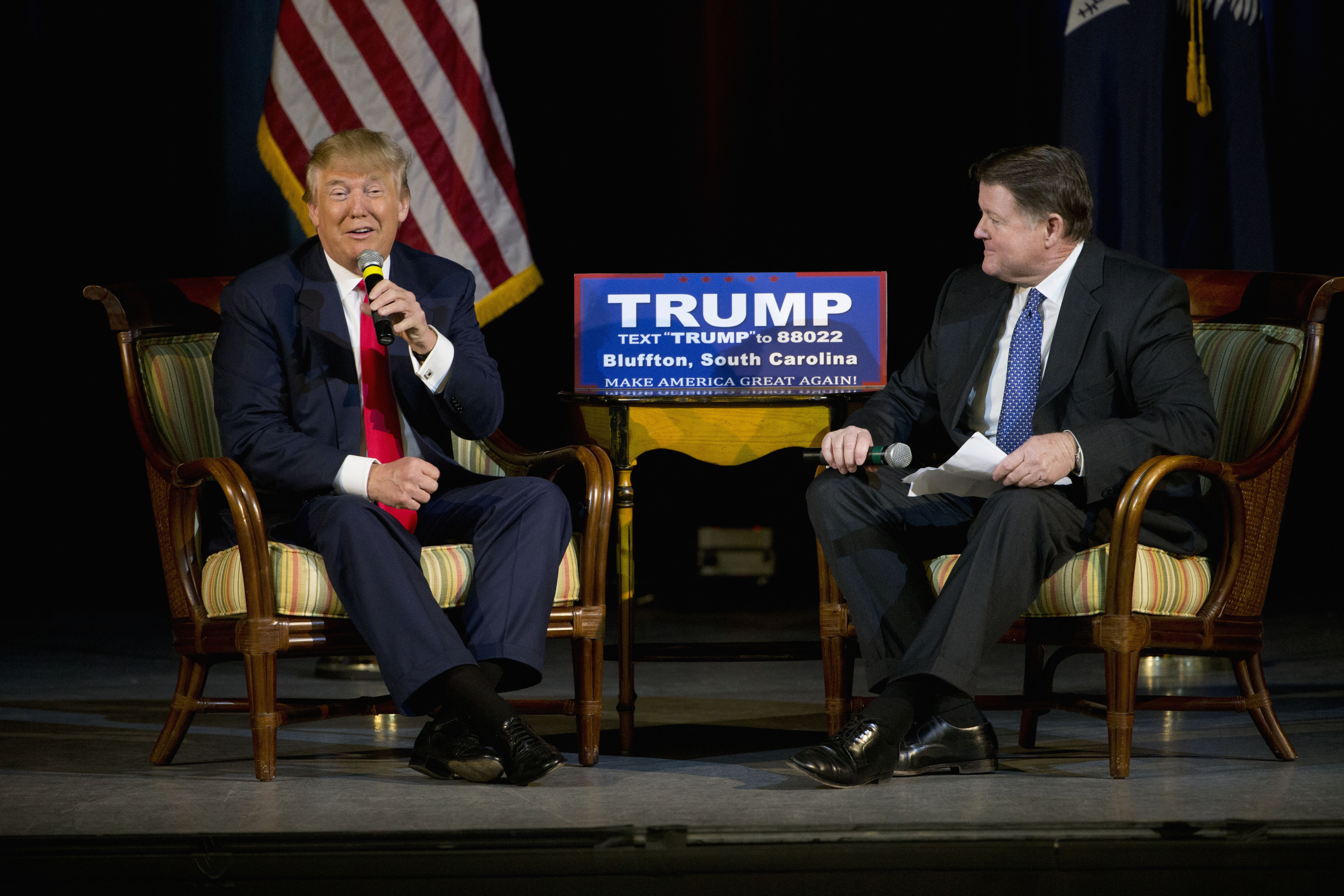 Republican presidential candidate Donald Trump, left, accompanied by South Carolina State Rep. Bill Herbkersman R-Beaufort, speaks during a campaign stop, Wednesday, Feb. 17, 2016, in Bluffton, S.C. (AP Photo/Matt Rourke)