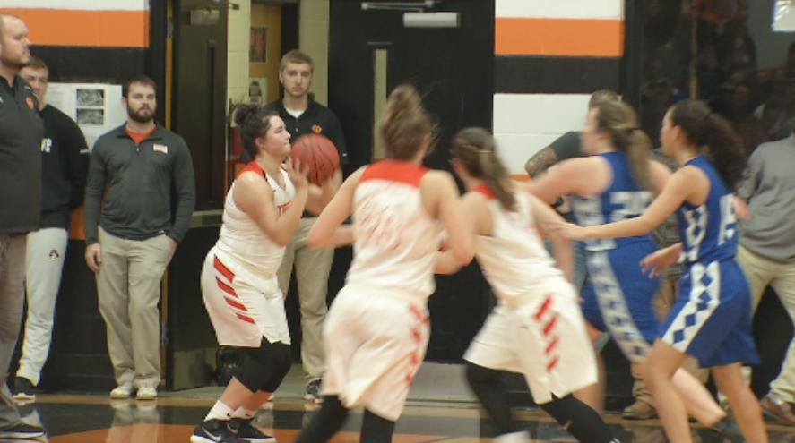 Rosman's Grace Owen lines up a three pointer against Brevard (WLOS Staff).jpg